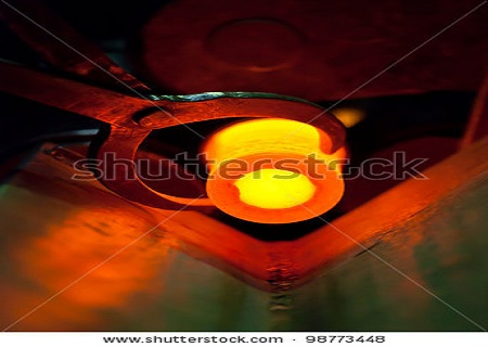 stock-photo-hot-steel-for-rolling-in-heater-98773448